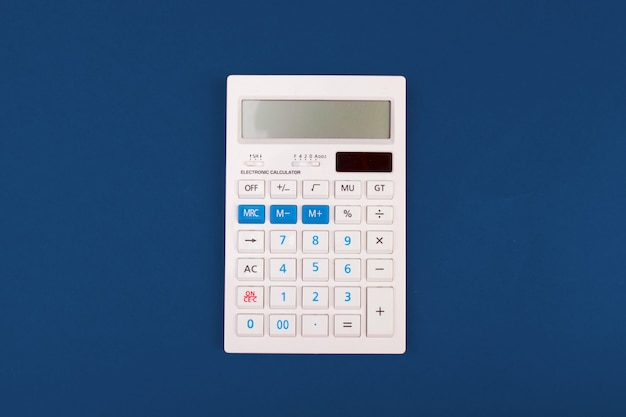 Top view of a calculator on a classic blue