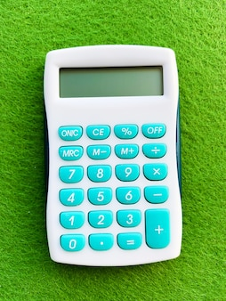 Top view of a calculator on gree