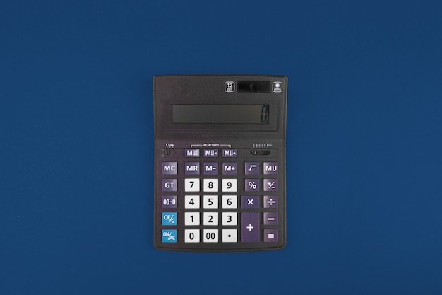Top view of a calculator isolated on classic blue