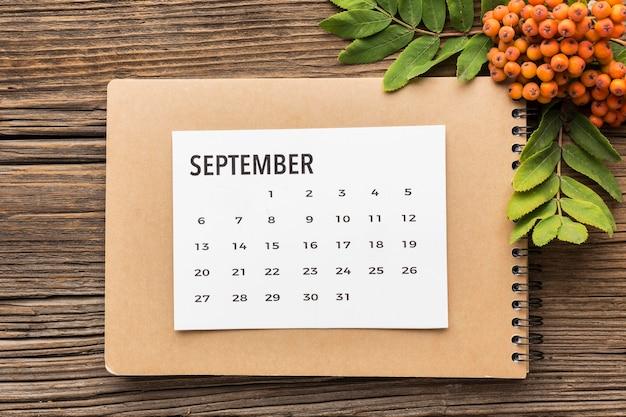 Top view of calendar with autumn sea buckthorn