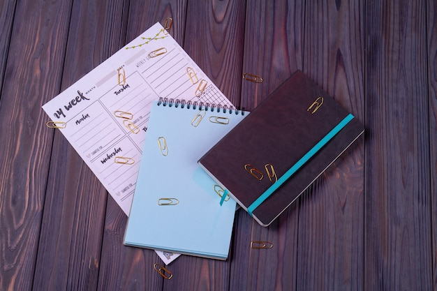 Top view calendar with copybook and notepad.