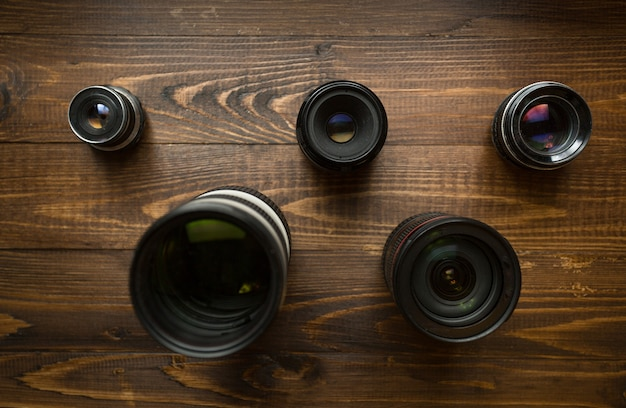 Top view of camera lenses organized in shape of olympic emblem