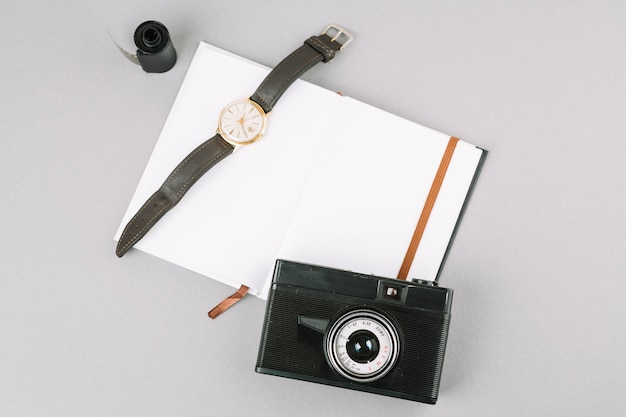 Top view camera with notebook and watch