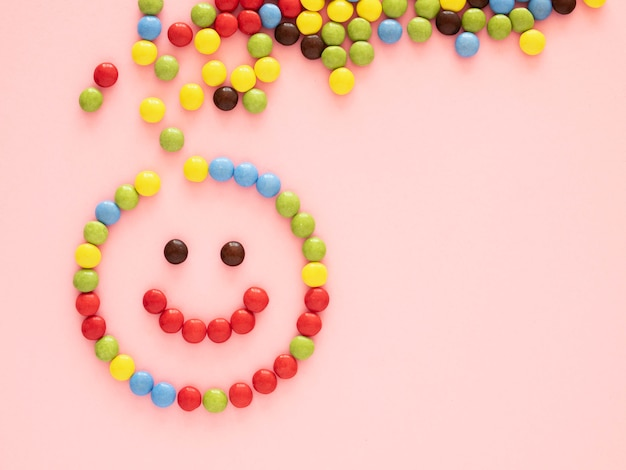 Top view candy on pink background