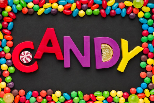 Top view candy word and sweets frame