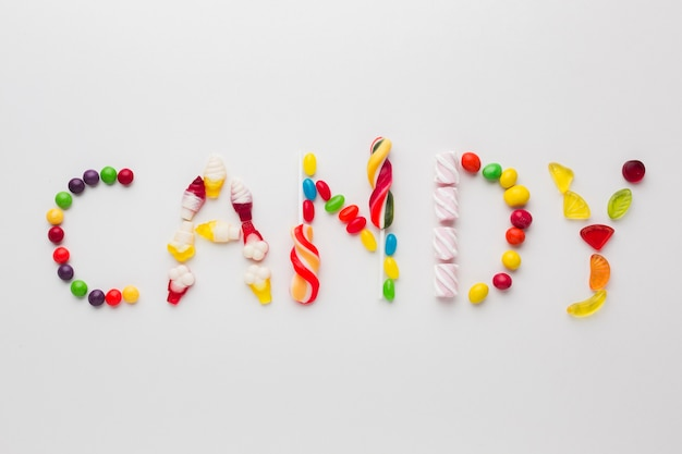Top view candy word written with sweets