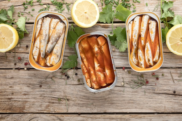Top view of canned fish with lemon