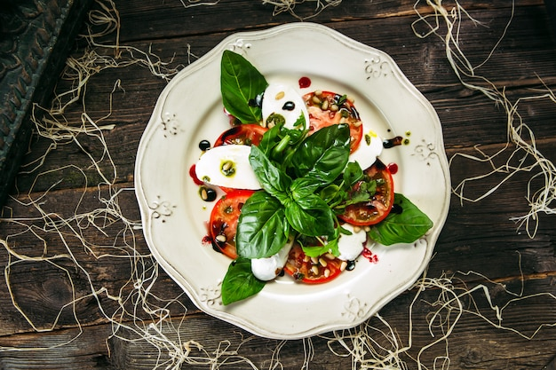 Top view on caprese salad tomatoes and mozzarella
