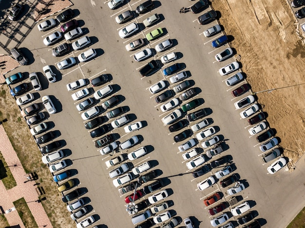 Top view of car parking texture aerial drone shot background f