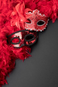 Top view of carnival masks with feathers and copy space