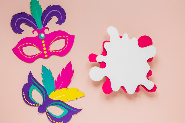 Top view of carnival masks with paper cut-out