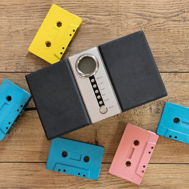 Top view cassettes on wooden background