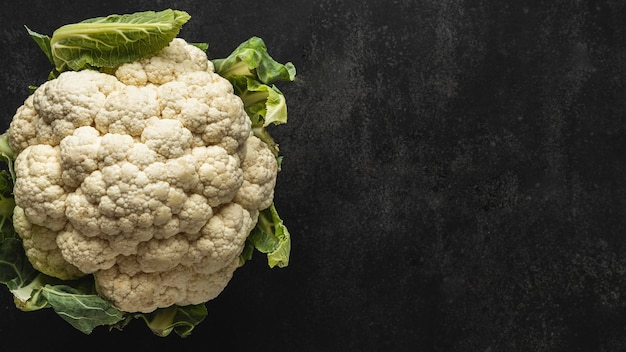 Top view cauliflower with leaves copy space