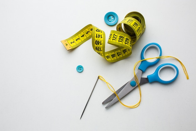 Top view centimeter of sewing and blue scissors