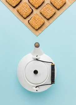 Top view ceramic teapot with homemade biscuits