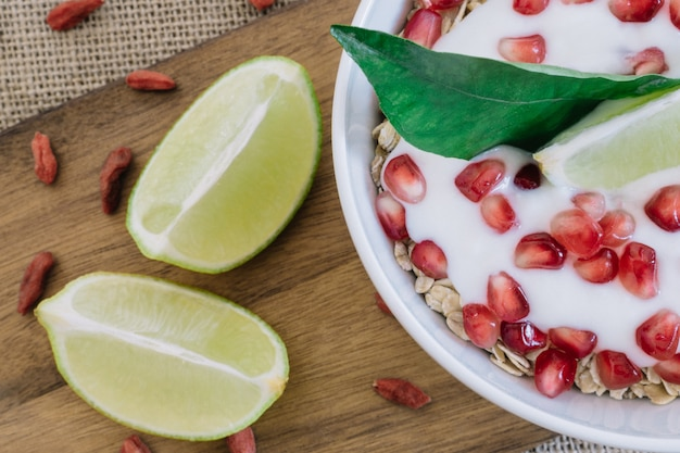 Top view of cereals with yogurt and pomegranate