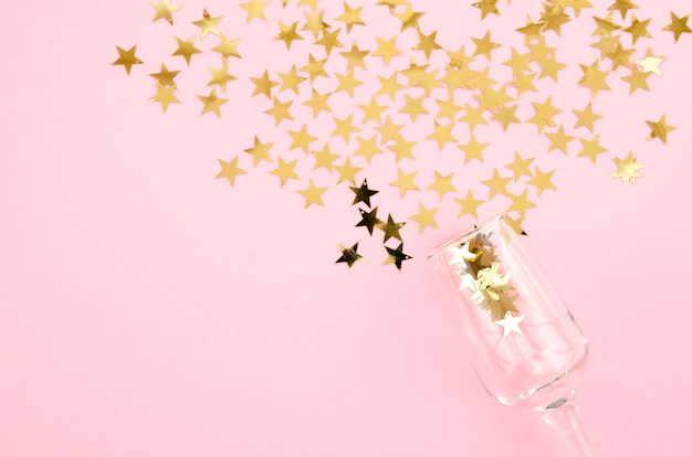 Top view champagne glass with stars