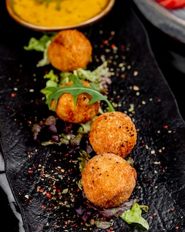 Top view cheese balls with spices and herbs