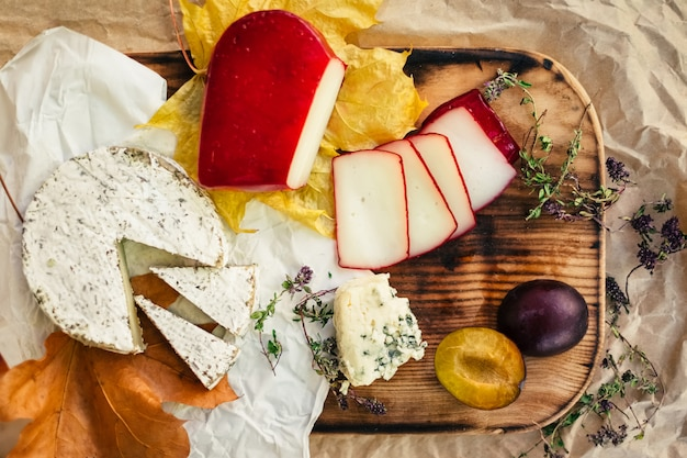Top view of cheese set on wooden background