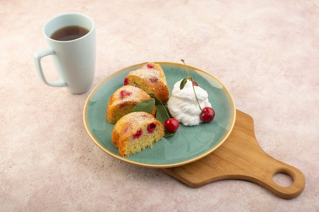 A top view cherry cake inside plate on the wooden desk with cherries on the pink desk cake biscuit sugar sweet