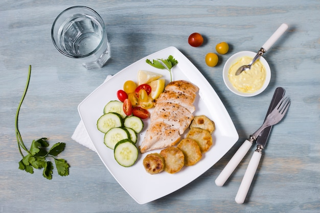 Top view of chicken breast with assortment of vegetables