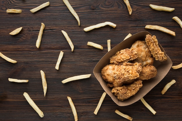 Top view of chicken and french fries