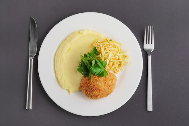 Top view of chicken kiev cutlet with mashed potato