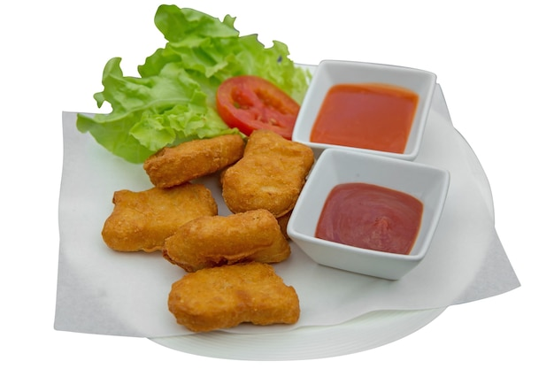 Top view of chicken nuggets with sauce and lettuce die cut on white isolated