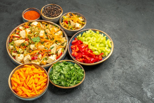 Top view chicken salad with vegetables on dark floor diet salad health