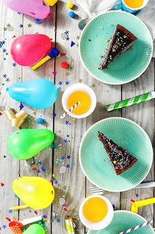 Top view children birthday table chocolate cake muffins decoration party
