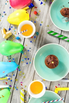 Top view children birthday table chocolate muffins decoration party