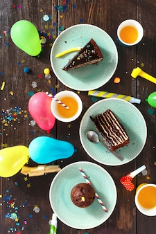 Top view children birthday table festive food chocolate cake decoration party