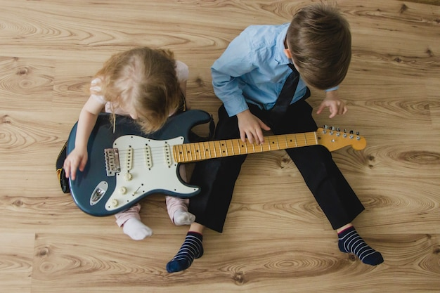 Top view of children with a guitar