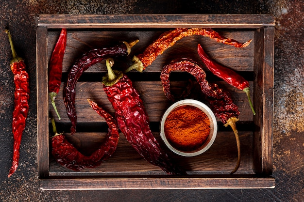 Top view of chili peppers on wooden tray