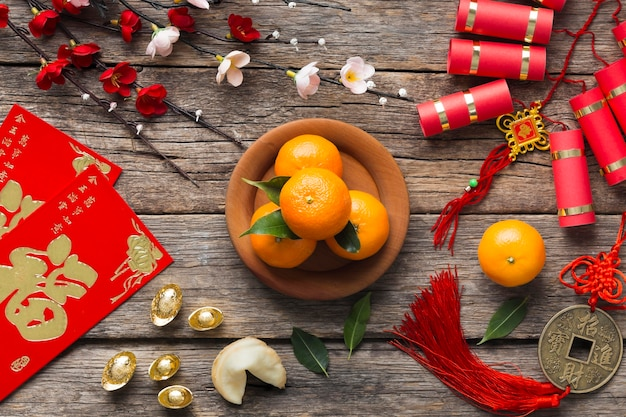 Top view of chinese new year concept on wooden table