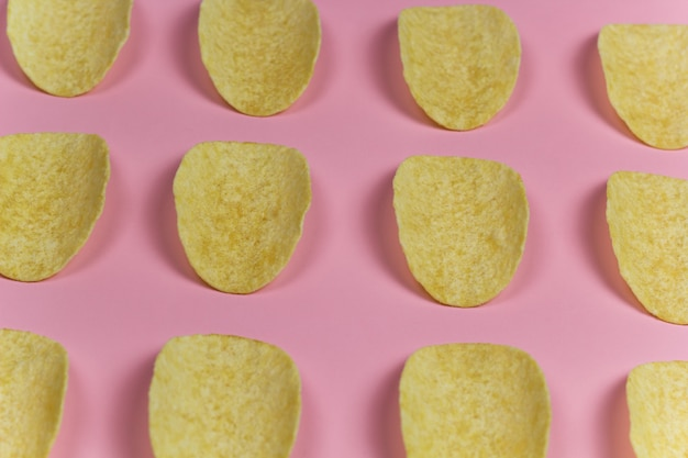 Top view chips pattern pink pastel background