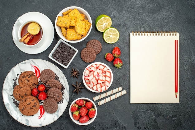 Top view choco biscuits with candies and tea