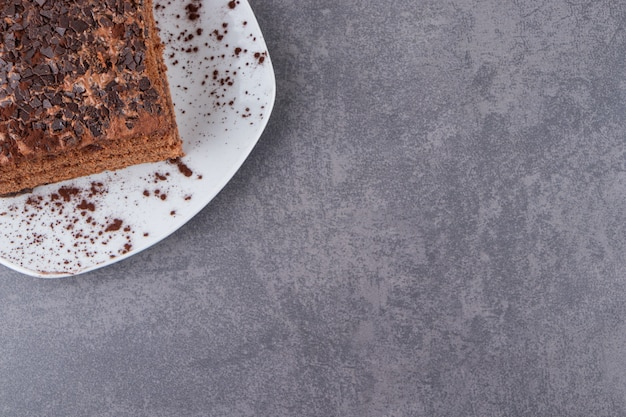 Top view of chocolate cake on plate over grey surface