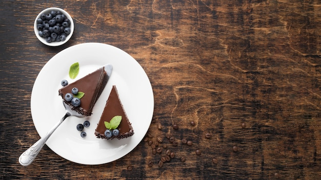 Top view of chocolate cake slices on plate with copy space