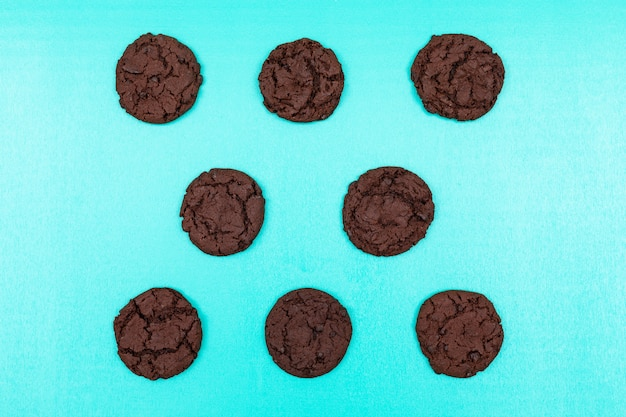 Top view chocolate cookies on blue surface