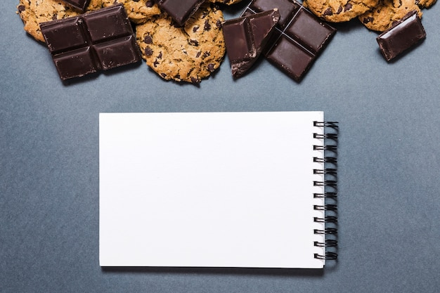 Top view chocolate frame with notebook