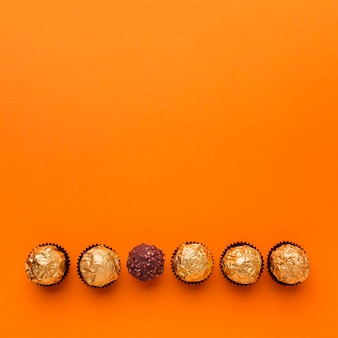 Top view chocolate pralines with copy space