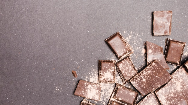 Top view chocolate tablets covered in cocoa powder