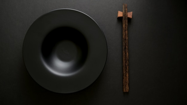 Top view of chop stick and empty plate