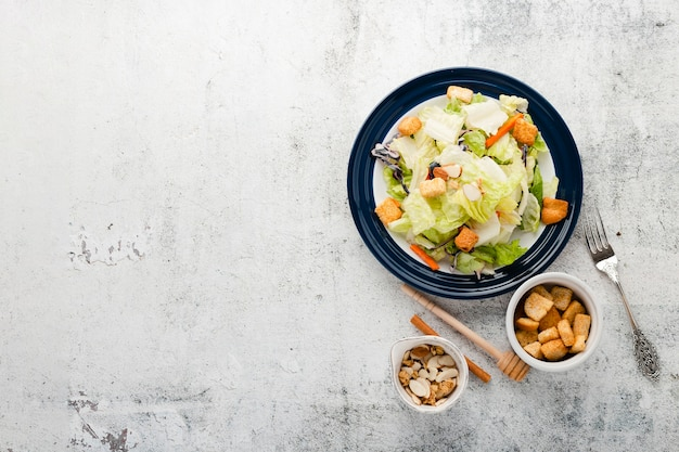Top view chopped salad with copyspace