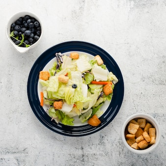 Top view chopped salad with croutons