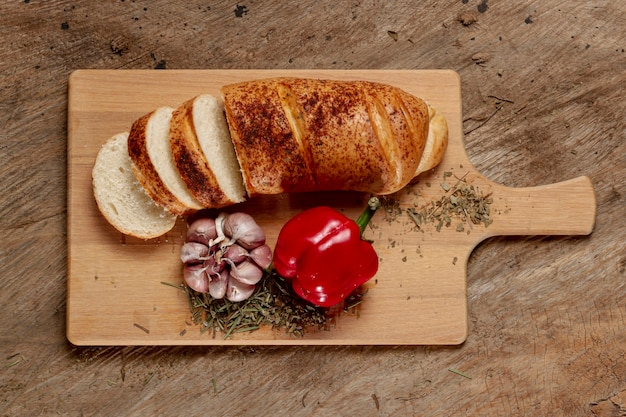 Top view chopping board with bread