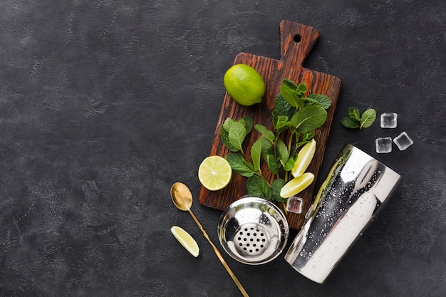 Top view of chopping board with cocktail essentials and copy space