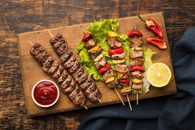 Top view of chopping board with delicious kebab and lemon