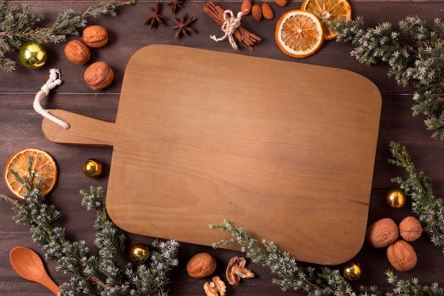 Top view of chopping board with dried citrus and cinnamon sticks